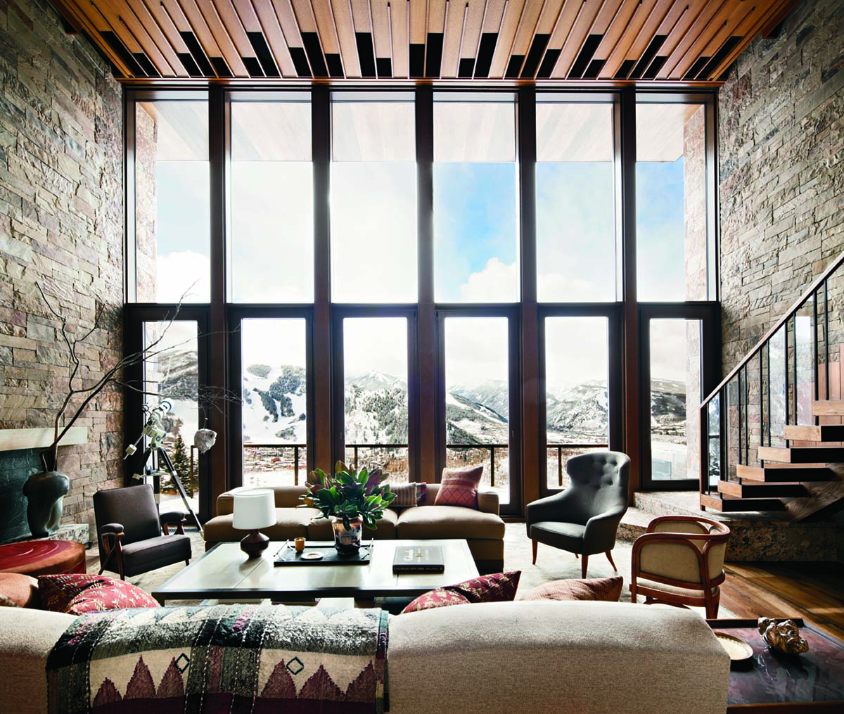 Stone walls flank mahogany ceiling and windows with views of the mountains in Aspen, Colorado.[1200×1015]